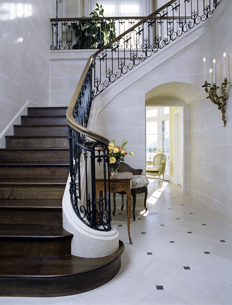 Fabulous-Stair-Railing-decorating-ideas-for-Arresting-Entry-Traditional-design-ideas-with-arch-banister-console-table-entry-table-floor-tile-design-foyer-french-limestone