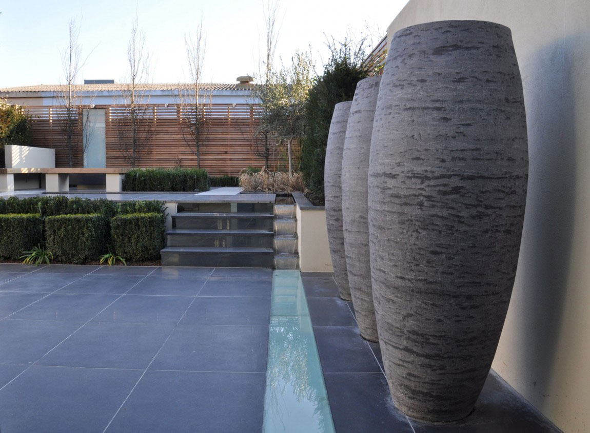exterior-modern-outdoor-space-for-with-three-large-stone-jars-and-plant-with-black-tile-floor-fabulous-outdoor-design-ideas