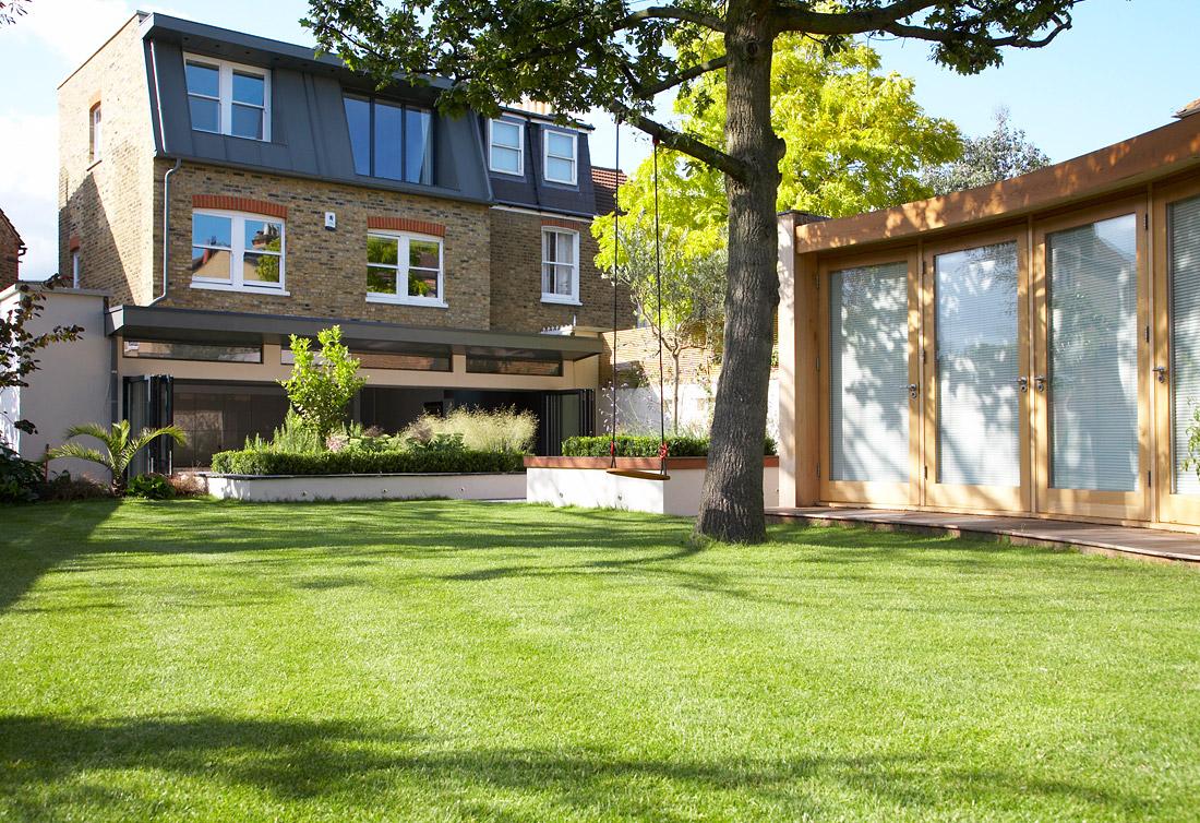 house-tour-exterior-backyard-tree-swing