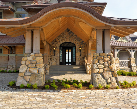 Charming-Traditional-Beach-Style-Entry-with-Exposed-Stone-Wall-Darkwood-Door-Design-Beach-Bay-Point-Exterior