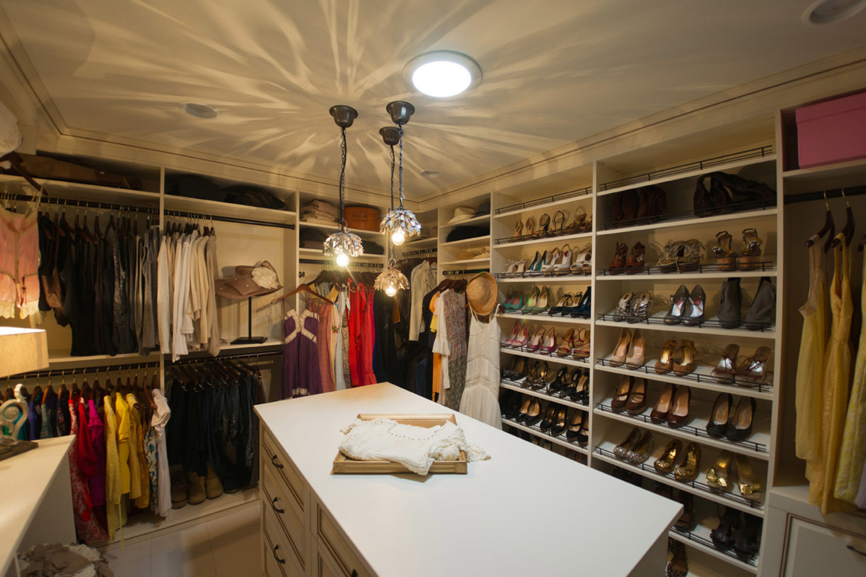 Classy-high-walk-in-closets-design-with-shoe-storage-and-cool-hanging-lamp-closet-shoe-storage-ideas