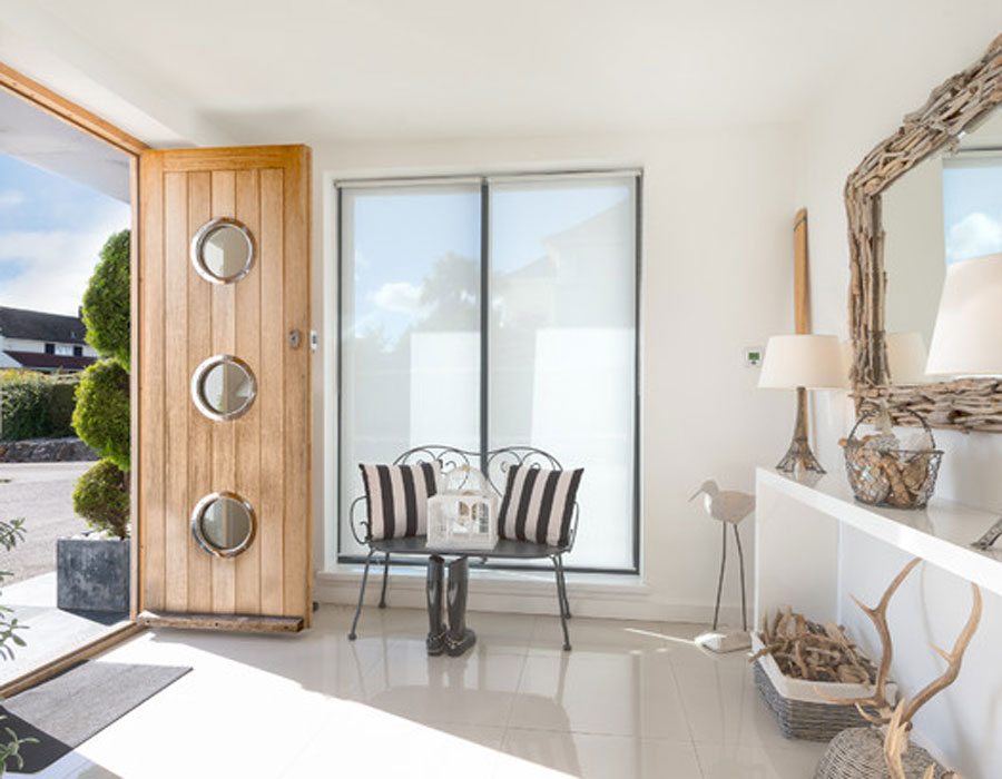 The-porthole-windows-shown-here-were-a-perfect-addition-to-this-beautifully-beach-style-home-decor-can-invite-the-morning-sun-in-to-brighten-the-sleek-and-comfy-entryway
