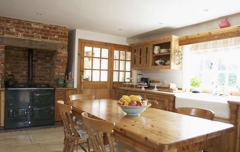 kitchen-cabinets-traditional-light-wood-hood-farm-sink