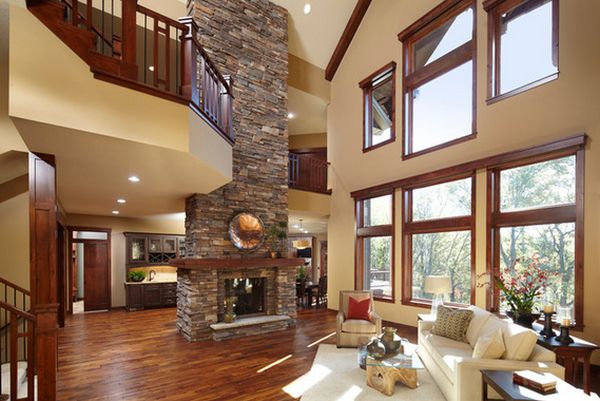 open-plan-living-room-with-stone-fireplace-high-ceiling-