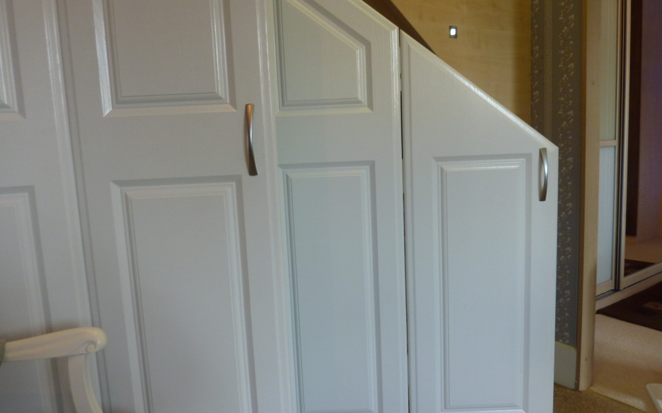 Cupboard-under-stairs-with-doors-open-