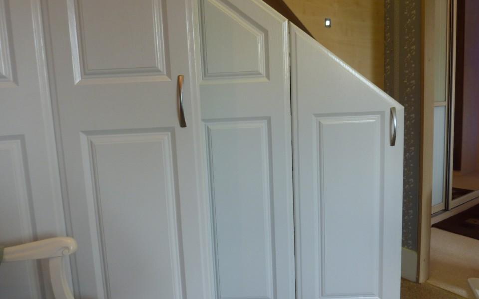 Cupboard-under-stairs-with-doors-open-