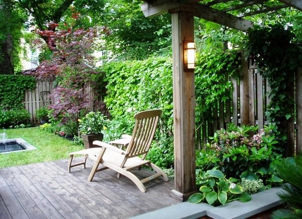 patio-deck-with-grapevine-arbor-lounge-chair-backyard-landscape