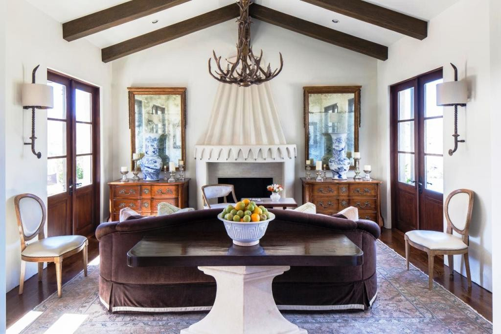 Mountains-Living-Room_Fireplace antler chandelier
