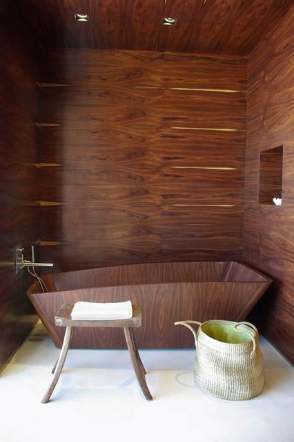 dark veined wood theme bathroom design.
