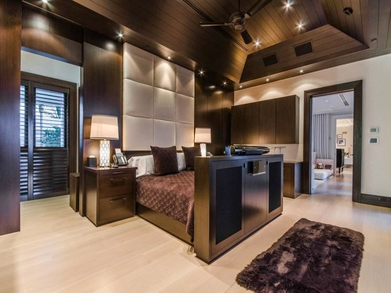 Dark master bedroom in Custom built celebrity home