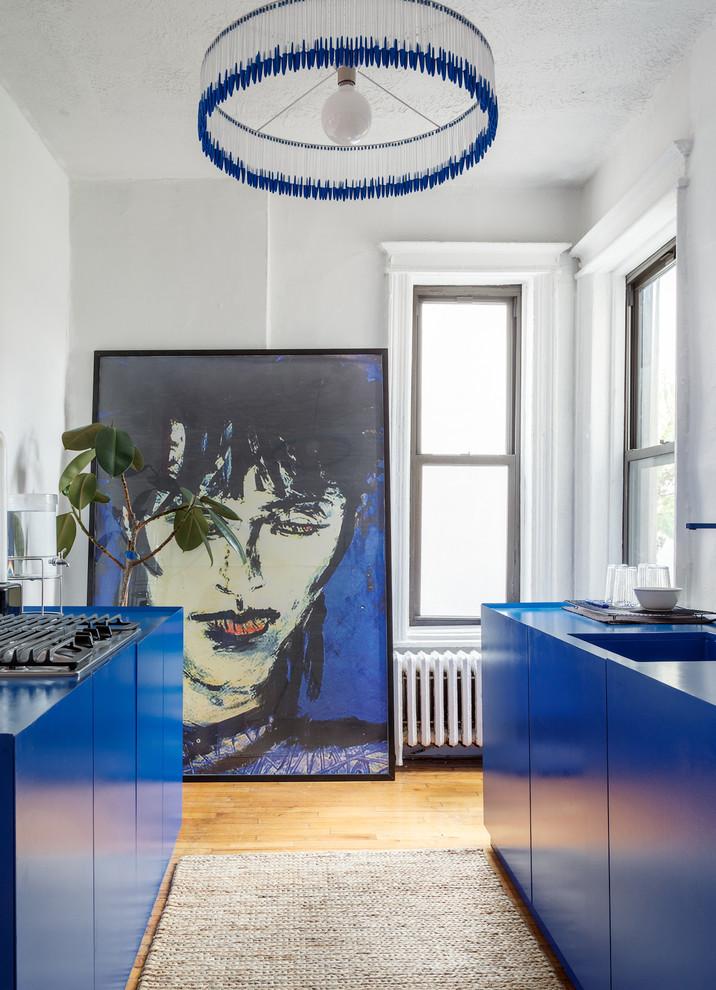Beautiful Apartment Kitchen With Dark Blue Laminate Cabinets Thewowdecor