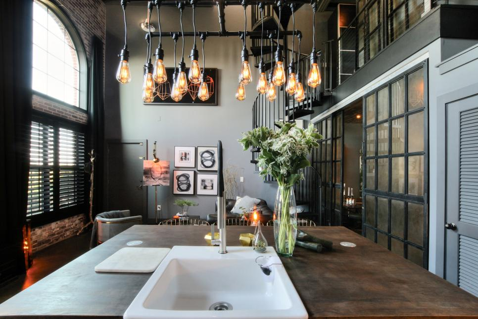 Open Industrial Kitchen With Bulb Pendants