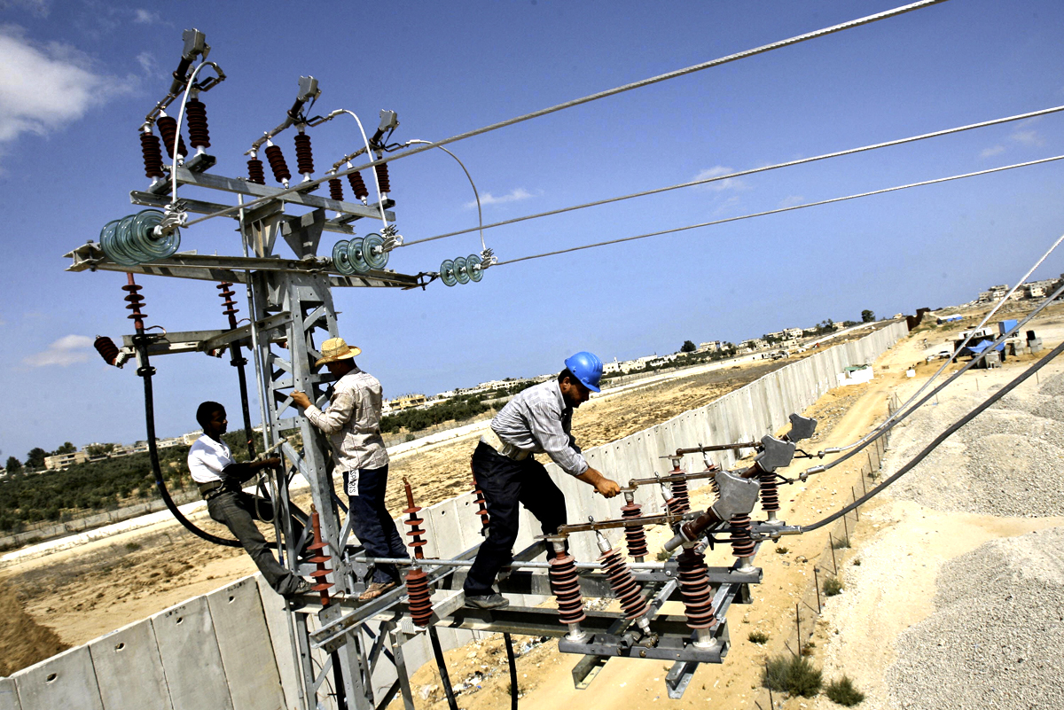 Palestinian electricity workers adjust t
