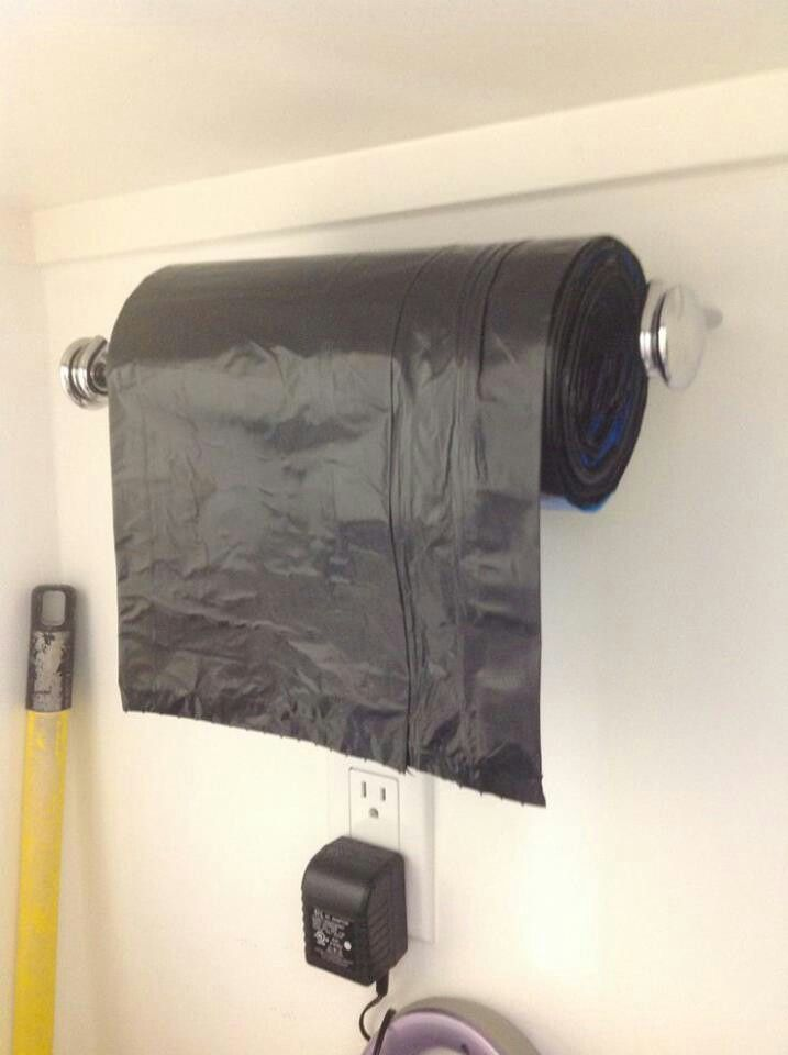Use a Towel Holder as a Trash Bag Dispenser