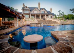 Cascade Swimming Pool Designs with an Impressive Home