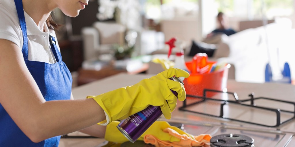 Maid cleaning stove top